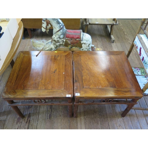 38 - A pair of Chinese hardwood occassional tables, the square tops over open friezes and turned legs, 61...