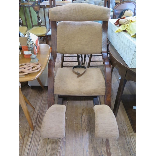 43 - A bentwood orthopaedic rocking chair, with beige upholstery...