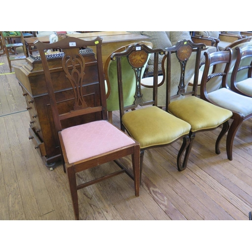 44 - A pair of Edwardian stained wood and ivorine inlaid salon chairs,  the carved backs inlaid with pane...