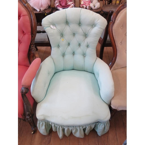 45 - A mid Victorian buttonback lady's armchair, with turned legs and pot castors...