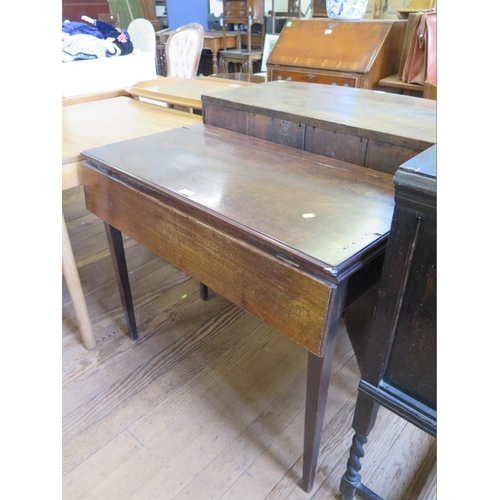 49 - A mahogany foldover tea table, with a drop leaf to the front, covering a frieze drawer, on square ta...