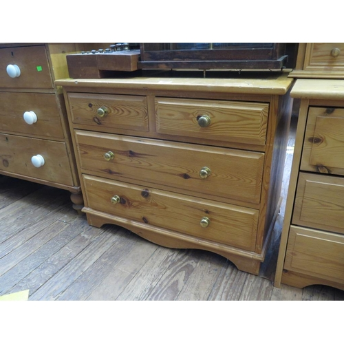 5 - A low pine chest of drawers, the two short and two long drawers on bracket feet, 79 cm wide, 45 cm d...