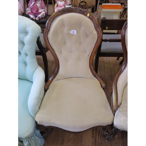 50 - A Victorian mahogany lady's chair, the spoon shaped button back with low scroll arms on cabriole leg...