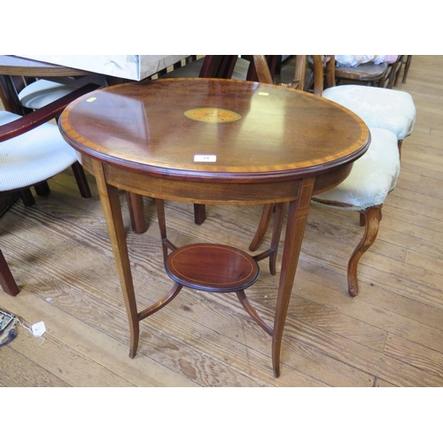 54 - An Edwardian mahogany and satinwood crossbanded oval window table, the top with central patera motif...