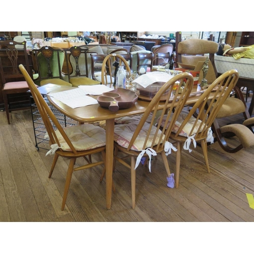 59 - An Ercol light elm rectangular dining table and four Windsor dining chairs, table 152 x 76 cm, label...