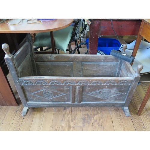 62 - A 17th century oak crib, the panelled sides carved with lunettes and lozenges, 95.5 x 57 cm...