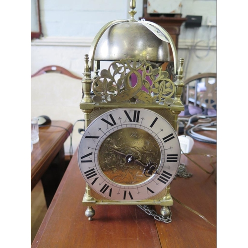 60 - An 18th century brass lantern clock, the rose engraved dial inscribed John Watts Stamford, with silv...