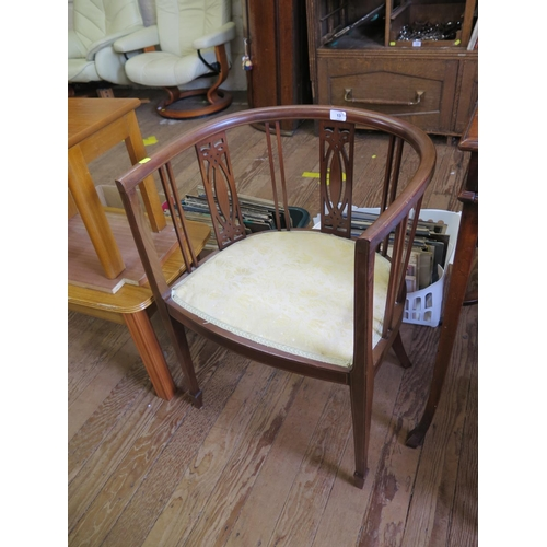 13 - An Edwardian boxwood strung mahogany tub chair, on square section legs with spade feet...