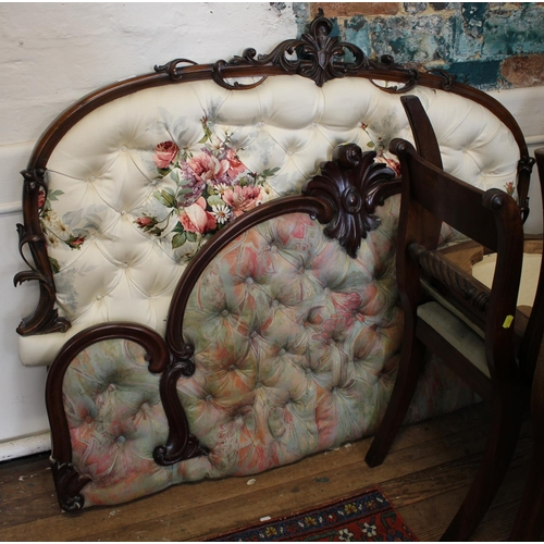 3 - A Victorian mahogany bed head, the arched frame with foliate spray centre and button back upholstery...