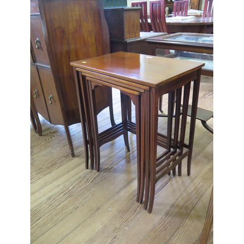 37 - An Edwardian chevron banded mahogany nest of three tables, the rectangular tops on square tapering s...