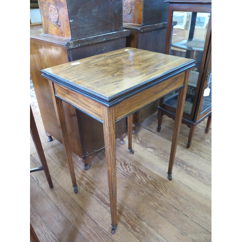39 - An Edwardian boxwood lined rosewood foldover card table, the hinged top on square tapering legs with...