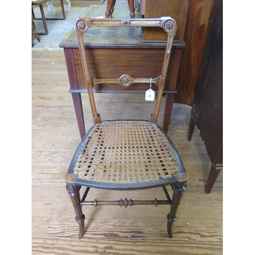 42 - A Victorian walnut bedroom chair with cane seat...