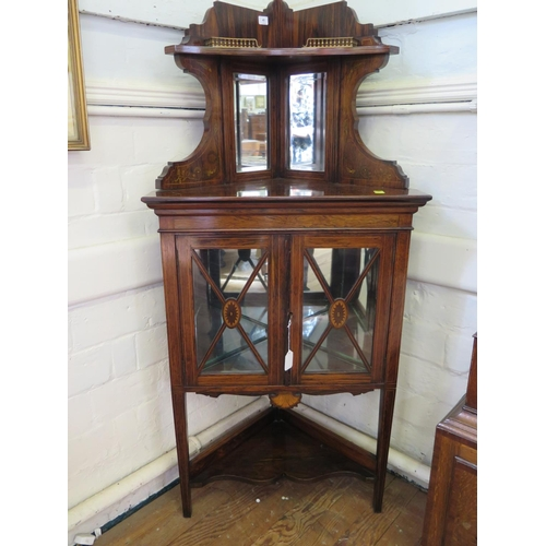 45 - An Edwardian inlaid rosewood corner cabinet, the raised galleried top with bevelled mirror back over...