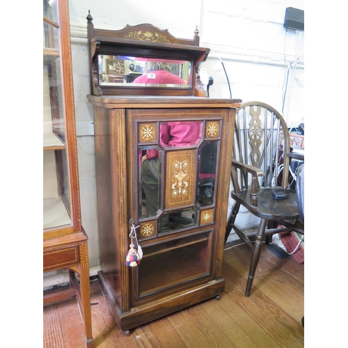46 - An Edwardian inlaid rosewood music cabinet, the raised mirrored back, over a mirrored, panelled and ...