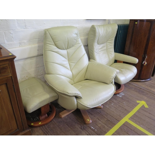 5 - An Ekornes Stressless cream leather upholstered armchair and footstool, and another cream leatherett...