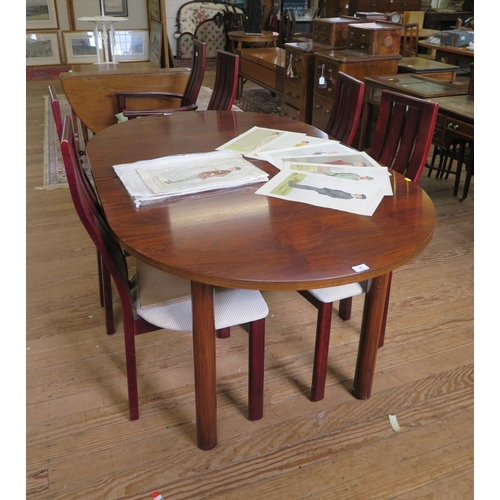50 - A Danish Skovby rosewood dining room suite, comprising a display cabinet, the twin sliding glazed do...