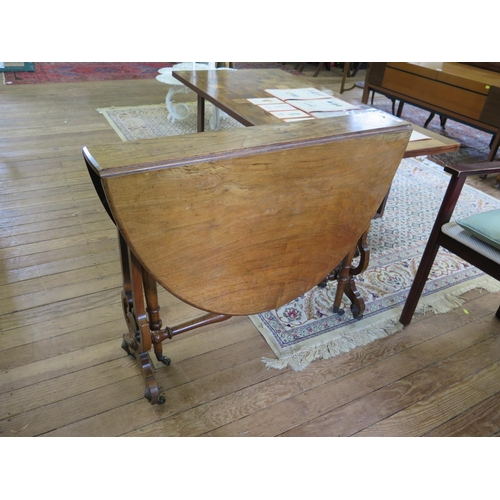 52 - A Victorian walnut oval Sutherland table, with lyre shape supports joined by a turned stretcher, on ...