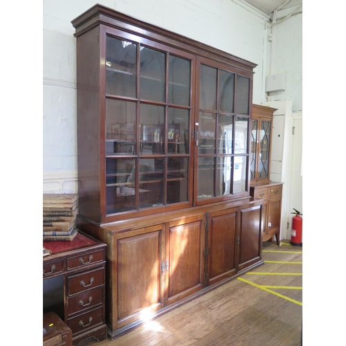 56 - A 19th century mahogany bookcase cabinet, the cavetto moulded cornice over a large pair of glazed do...