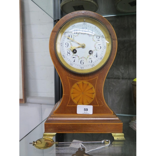 59 - An Edwardian inlaid mahogany balloon mantel clock, the case with central patera, on brass ogee feet,...