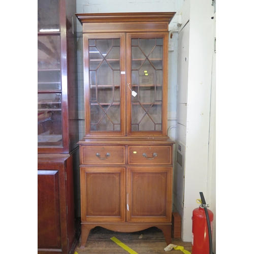 7 - An Edwardian mahogany and crossbanded satinwood bookcase cabinet, the astragal glazed pair of doors ...