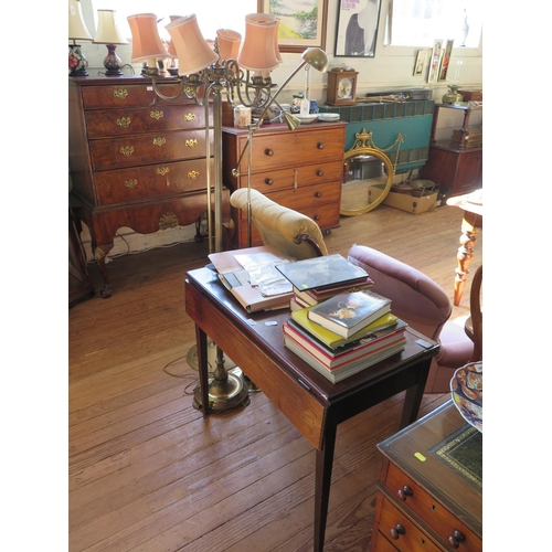 10 - A brass six light standard lamp, the scroll arms on a reeded column, with circular base and paw feet...