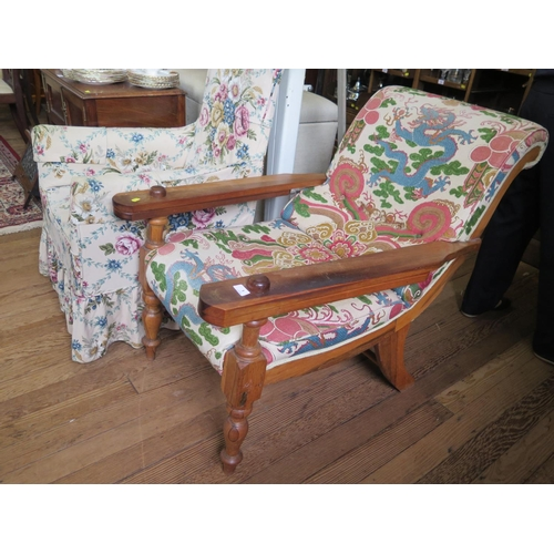 1 - A Colonial wood planter's chair, with later upholstered back and seat, swing out arms and turned tap...