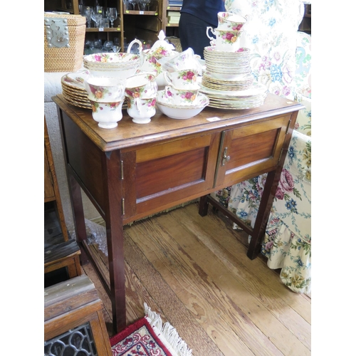22 - An oak and mahogany side table, with twin doors on square section legs, 74 cm wide and a late Victor...