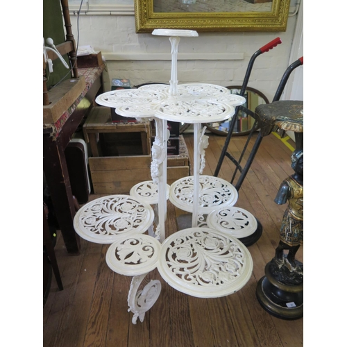 30 - A Victorian painted cast iron three tier plant stand, in the style of Coalbrookdale, each tier with ...
