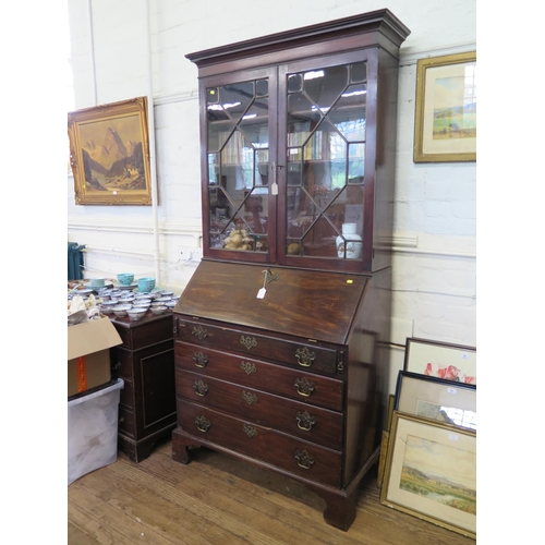 31 - A George III mahogany bureau bookcase, the astragal glazed twin doors over a sloping fall above four...