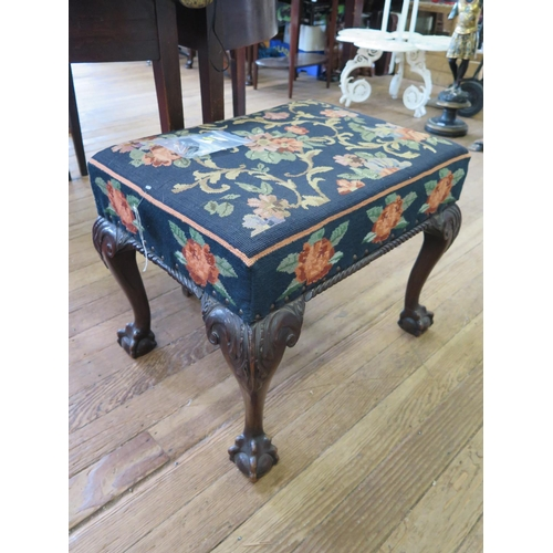 32 - A George III style mahogany stool, the woolwork seat over a gadrooned edge and acanthus carved cabri...