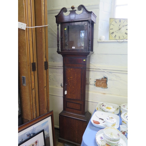 48 - An early 19th century oak and mahogany crossbanded longcase clock, the swan neck pediment over a pai...