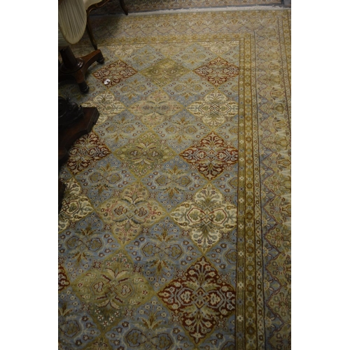 10 - Indian Persian pattern woollen carpet of all-over floral design with multiple borders on a blue grou...