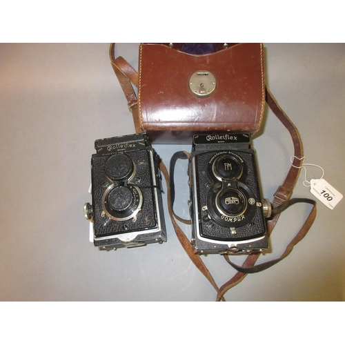 100 - Rolleiflex twin lens camera in original leather case, another similar and another case lacking...