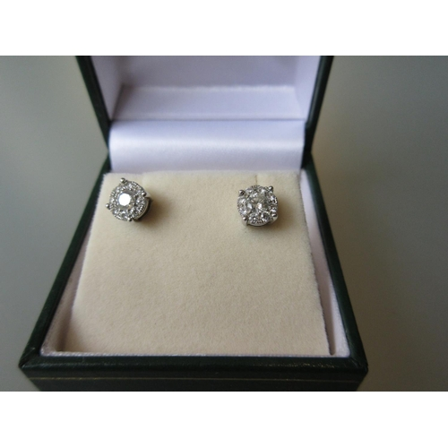 1010 - Pair of 18ct white gold diamond cluster stud earrings...