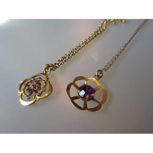 1014 - Gold plated garnet set pendant on chain and a 9ct gold chain with yellow metal pendant...