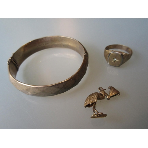 1027 - 9ct Gold bangle, 9ct gold signet ring and a 9ct gold charm...