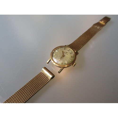 1031 - Ladies Omega 18ct gold cased wristwatch with an 18ct gold strap...