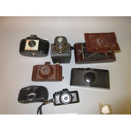 104 - No. 2 Hawkette Bakelite cased folding camera, two other Bakelite cased cameras, Pentax Auto 110 mini...