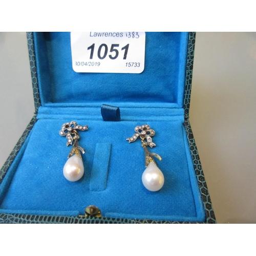 1051 - Pair of diamond and pearl set drop earrings...