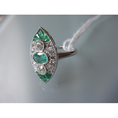 1052 - 18ct White gold and platinum marquise shaped emerald and diamond ring in Art Deco style...