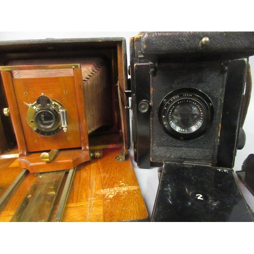 114 - 19th Century mahogany plate camera together with a Junior special plate camera with various plate ho...