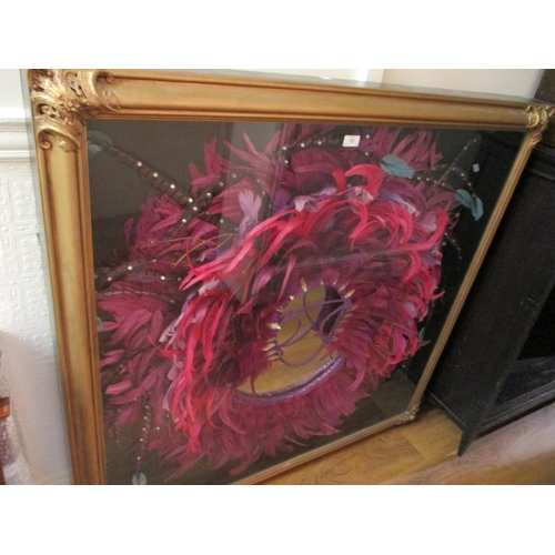 12 - Large gilt framed Brazilian feathered carnival headdress / costume later mounted with a mirror, 4ft ...