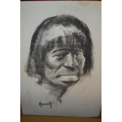 1330 - John Hassall, charcoal on board, head of a South American Indian, signed and unframed...