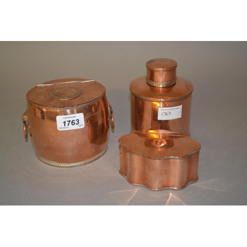1763 - Two 19th Century copper tea caddies, the hinged covers inset with copper coins together with a circu...