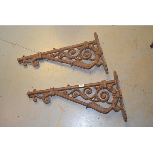 1765 - Pair of weathered cast iron wall brackets, each of right angled scroll design...