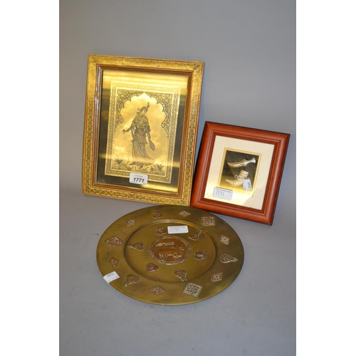 1771 - Far Eastern circular brass plate, framed Persian metal plaque and a framed miniature silver dagger...