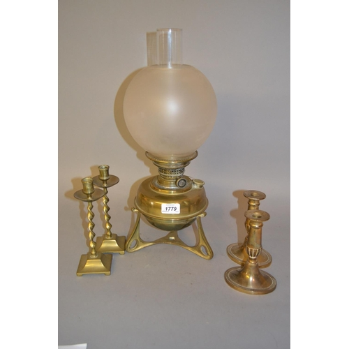 1779 - Brass oil lamp together with two pairs of brass candlesticks...
