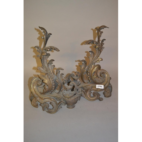 1780 - Pair of 19th Century brass rococo design fire dogs...