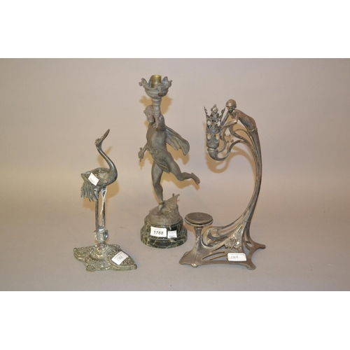 1788 - W.M.F. figural candle holder together with a French spelter figural table lamp and a brass figure of...