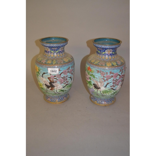 1802 - Pair of Chinese cloisonne baluster form vases decorated with herons and flowers within a landscape, ...